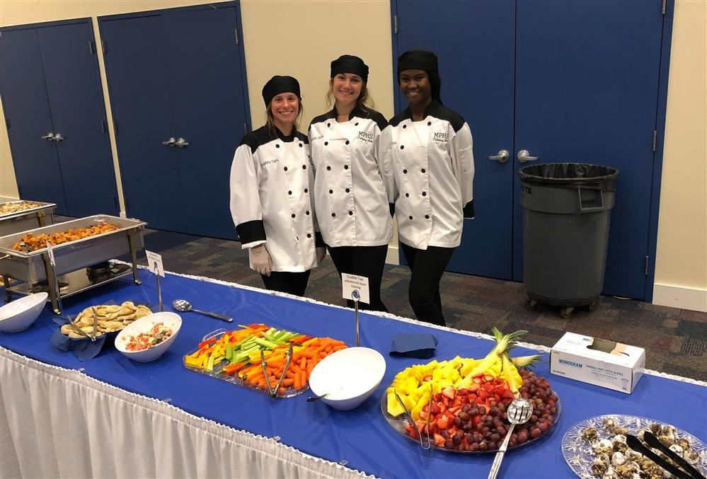 culinary students at buffet table