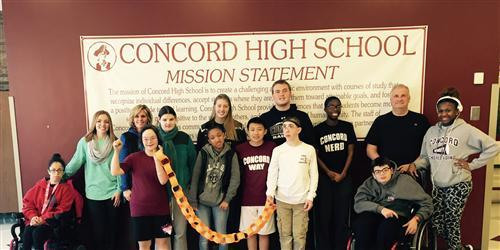 Concord kids in front of the CHS mission statement